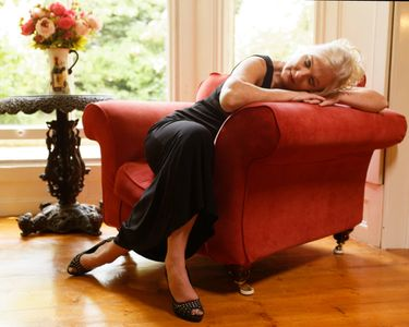 Sleeping woman on red chair