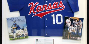 Sport memorabilia framing in Wichita examples of signed jerseys shadow box and sport collectables