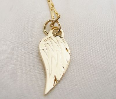 gold angel wing, 9ct gold wing, hallmarked handmade gold jewellery, 9k gold wing