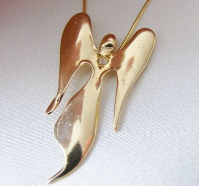 gold angel, elegant angel with a diamond, 9ct gold angel, gold angel jewellery, hallmarked gold angel