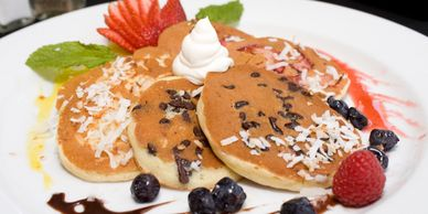 PANCAKES AND CHOICE OF A WIDE SELECTION OF FRESH FRUITS, EXOTIC NUTS, HOMEMADE CREAM AND SYRUP SAUCE