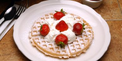 WAFFLES AND CHOICE OF A WIDE SELECTION OF FRESH FRUITS, EXOTIC NUTS, HOMEMADE CREAM AND SYRUP SAUCE