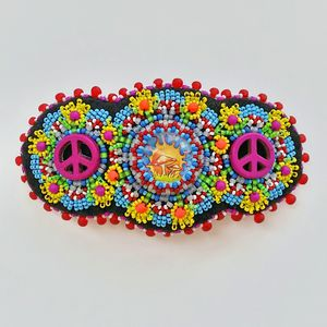 Peace signs and magic mushrooms make this whimsy hair accessory come alive.