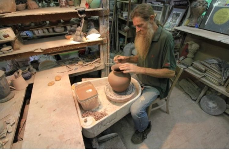 Joppa Mountain Pottery - McDonald turns what will become a pitcher on his wheel in East Tennessee
