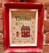 """Christmas Is..."" now available through your local needlework store."