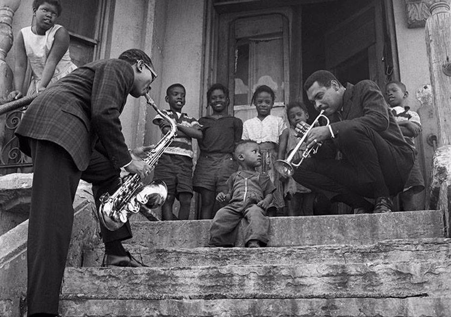 Picture of Benny Golson and Art Farmer with Harlem children, by Ted Williams