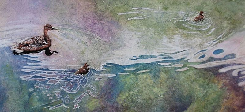 Watercolour batik painting of mother duck and babies.