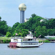 Knoxville Sunsphere and Tennessee Riverboat on the river in downtown Knoxville, TN.