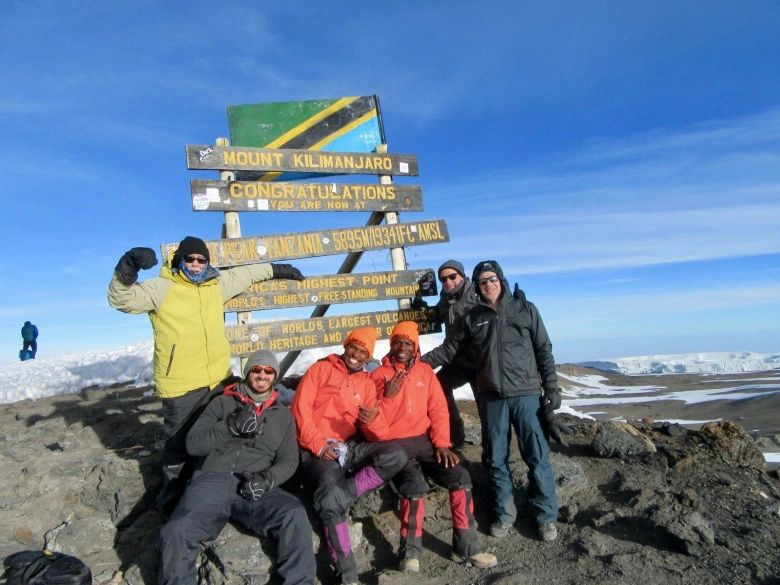 Only months ago, the author (in yellow jacket) and friends stood on the top of Mt. Kilimanjaro in Tanzania, at 19,341 feet the tallest summit in Africa. Like the still wildlife-rich Serengeti Plain, Knight says the diversity of wildlife in Greater Yellowstone, his home region, is a miracle that needs safeguarding. Photo courtesy Phil Knight