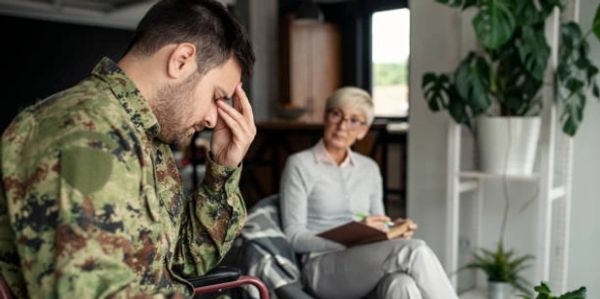 Soldier with PTSD in therapy, discussing the trials and tribulations of this horrific condition.