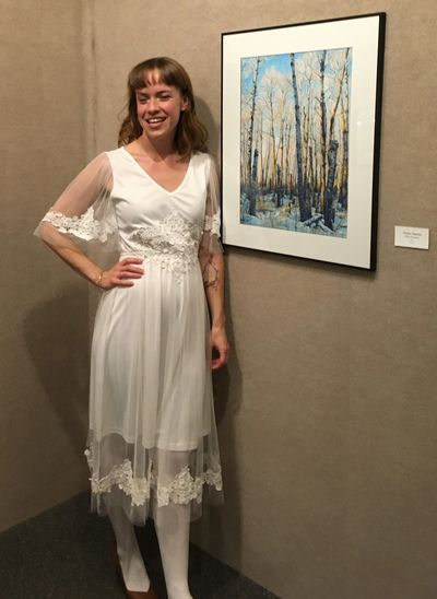Justine Bouchard on opening night of the 'Peace Roots' exhibition standing by the original piece 'Poplar Opinion'