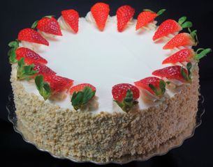simple and light.... cake, sandwiched with sliced strawberries, custard and cream