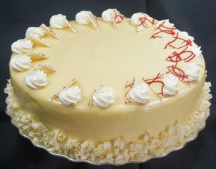 our decadent & irresistible  white chocolate raspberry gateau