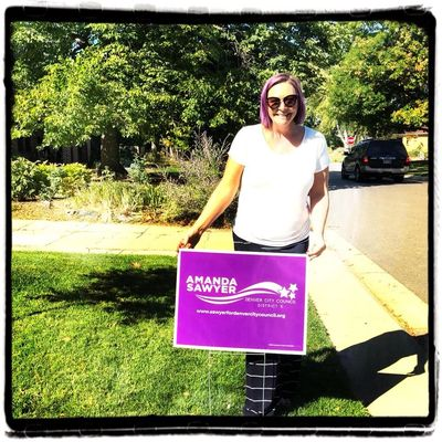 May 2019 Denver City Council candidate Amanda Sawyer putting up yard signs with volunteers.