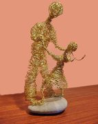 """Dancing With Daddy"" brass wire sculpture"