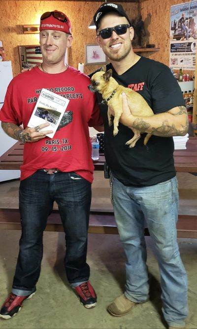Adam Sandoval and his dog Scooter.