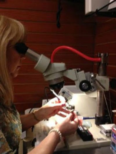 Image of a broken hearing aid being repaired in Orange City. Photo inside Hearing Aid Repair Shop