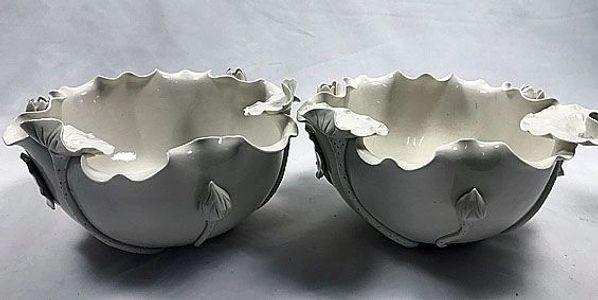 A pair of blanc de Chine bowls with applied floral decoration Chinese late 19th. cen., 4.5 x 8.5ins
