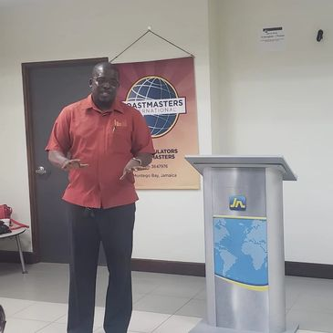 A captivating JJ delivers to the members of the JN Articulators Toastmasters Club in Montego Bay.