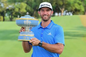 PGA golfer Dustin Johnson poses with the trophy for winning the 2019 WGC Mexico Championship.