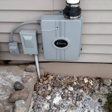 Radon fan is installed on the exterior of the house where the other utilities are located.