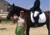 "Coach Lydia poses with Mandy on ""Equishare Emmitt"" at the 2002 Regional Dressage Championships."