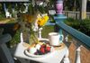 Handcrafted breakfast on the porch is a guest favourite