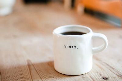 Coffee cup with word begin. Change begins now.