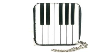 Practice your scales on this hand sized keyboard purse!