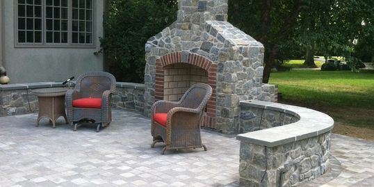 outdoor fireplace with paver patio