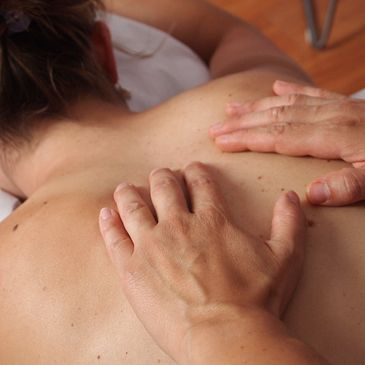 Woman getting back massage. 60 minute massage 34652 prenatal, deep tissue, myofascial, clinical,