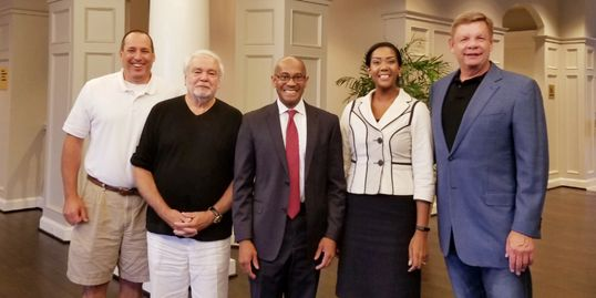 South Charlotte Partners Board Members Tim Morgan, Ray Eschert, Victoria Nwasike with Marcus Jones