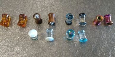 Plugs and Flesh Tunnels made from natural materials, Pyrex and Titanium Ion Plated over 3.16 surgical steel