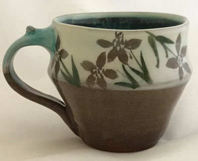 "Stoneware mugs fired to cone 6 with original hand painted designs. $35.00  H 3.5"" W 4""   5"" at handl"