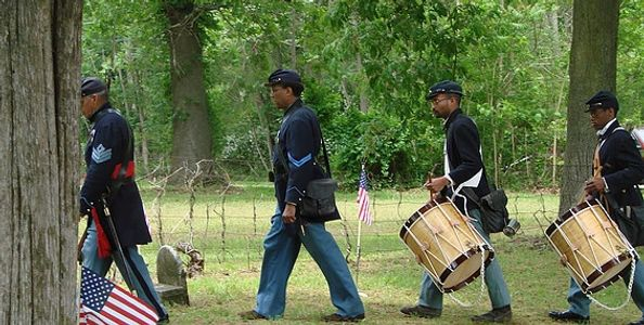 US Colored Troops marching through Timbuctoo Cemetery