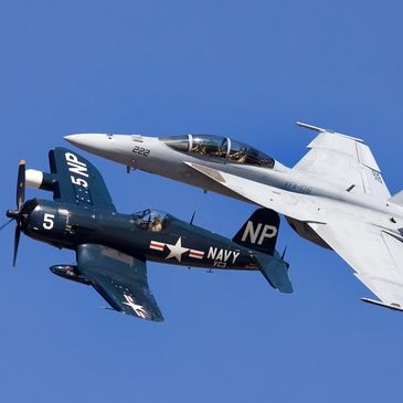 F-18 & a warbird flying in formation