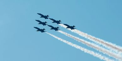 6 F-18 Hornets flying in formation