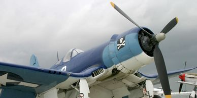 Blue and white warbird on the tarmac
