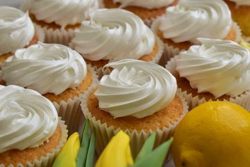 bio organic lemon cupcakes filled with lemon curd and meringue frosting
