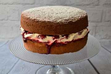 victoria sponge cake with homemade berry coulis fresh berries and vanilla whipped cream