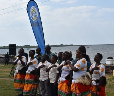 TASO Entebbe Drama Group leading the TASO Anthem during a function at Kigungu Landing site
