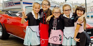 Group of Girls in Poodle Skirts