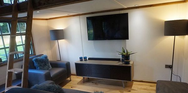 "Lounge Area with 50"" Smart TV Leather SofaBed and Armchair"