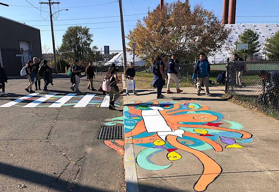 School Zone Art on storm drains and crosswalks increase awareness of waterways and school zones