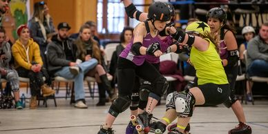Painway and her teammates take our a jammer