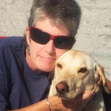 Dr Patrice Covington and her rescued yellow lab River