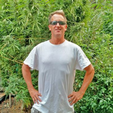 mike greenfield in front of cannabis
