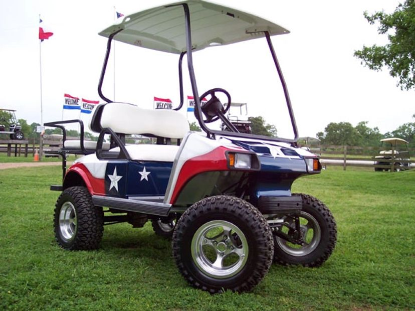 Club Car DS, Texas Flag custom paint, lifted, rear seat, aggressive wheels, golf cart