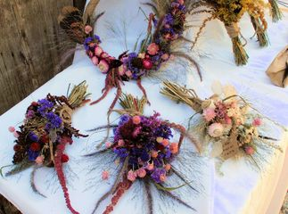 dried flower wreath and dried flower arrangements with purple and pink colors