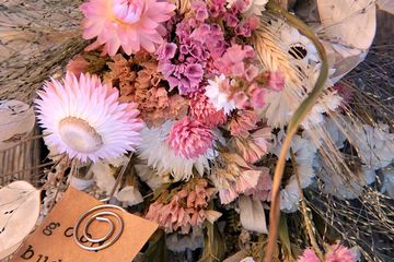 cool pastel and baby pink dried flower arrangement